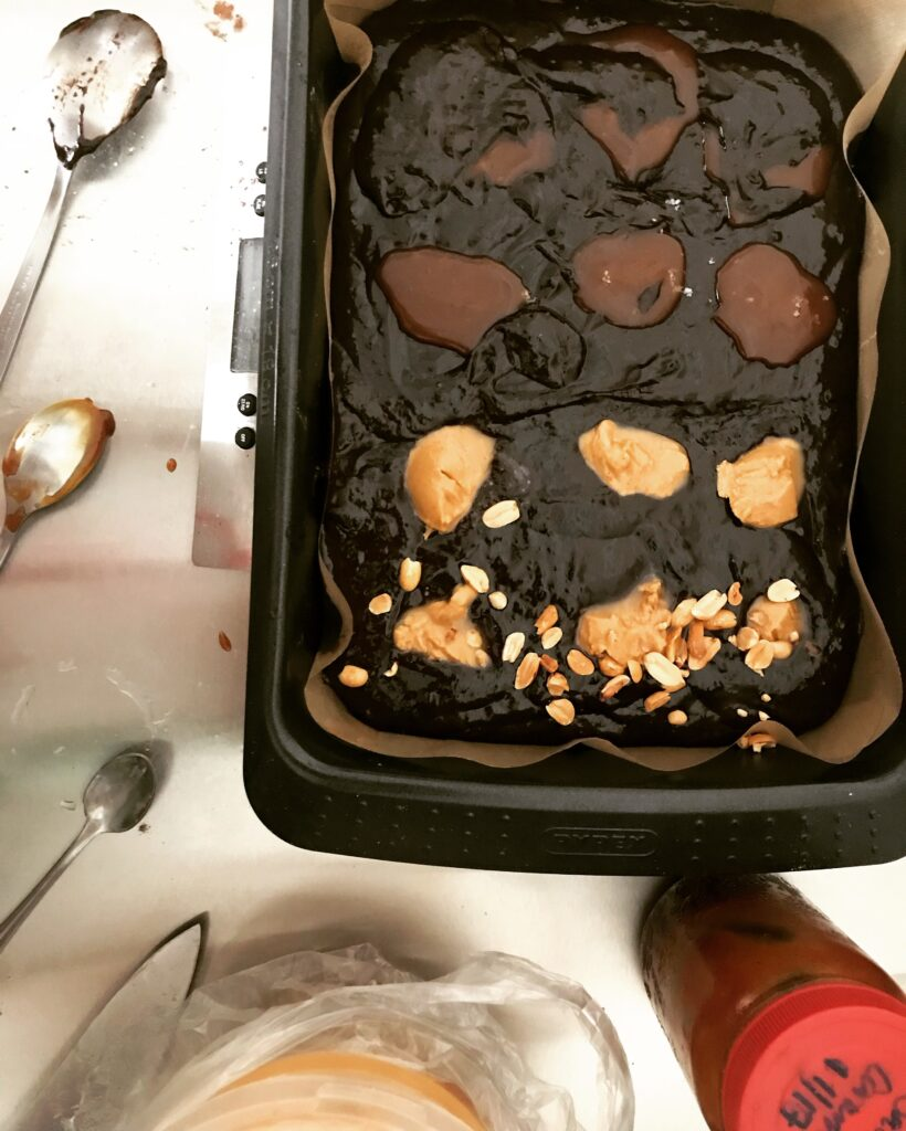 Experimenting with peanut butter and salted caramel brownies.